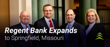 Picture of four bankers who have been hired for the Springfield expansion