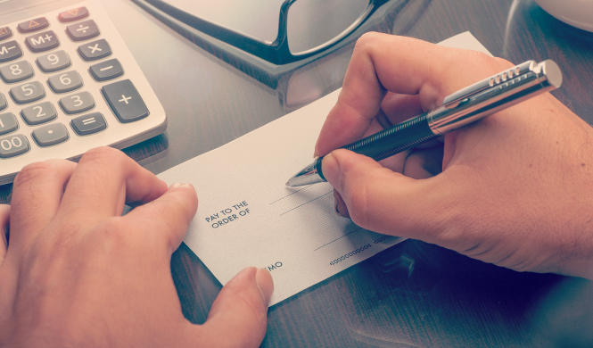 image of person hand writing check