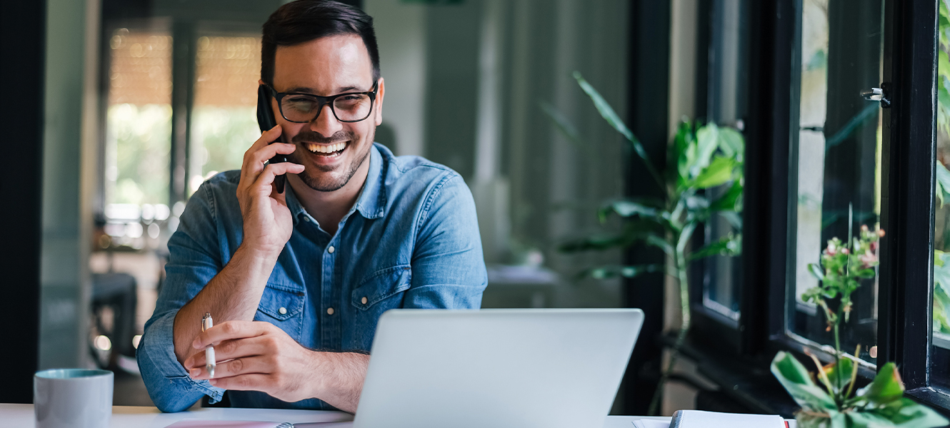 home banner business owner smiling on phone